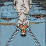 Two of Swords Reversed Meaning